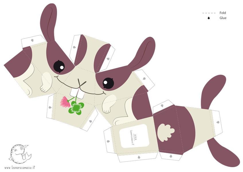 Paper toy da montare di un coniglio con un quadrifoglio in bocca